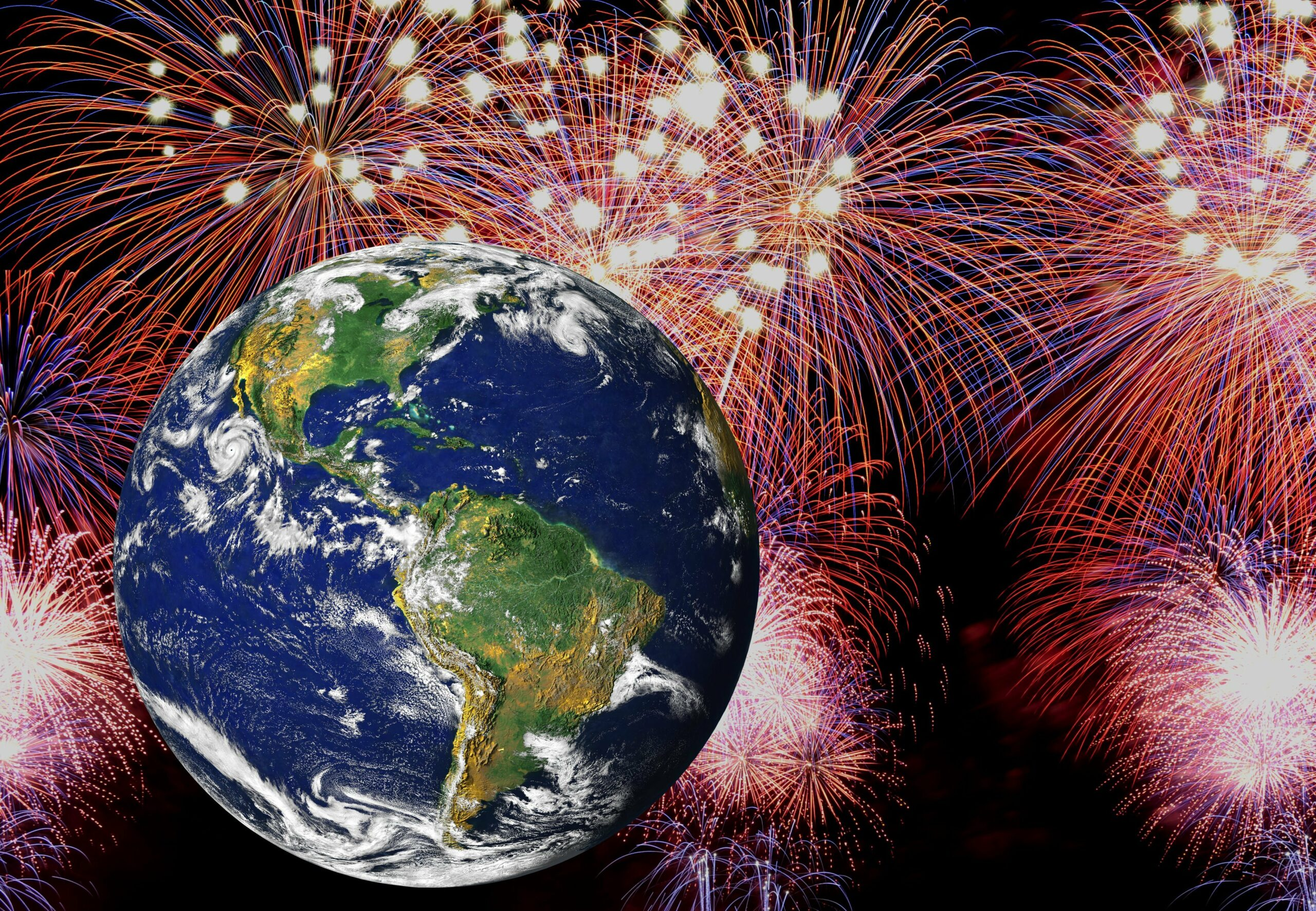 Earth surrounded by fireworks